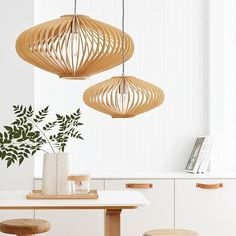 We love timber with a twist. The uniquely designed slats on the Kiel Pendants create a soft, shadowy effect. Cluster a pair to create maximum impact and get 40% off your second during our Catalogue Sale.  #timber #lighting #ontrend #beaconlighting  #homeinspo