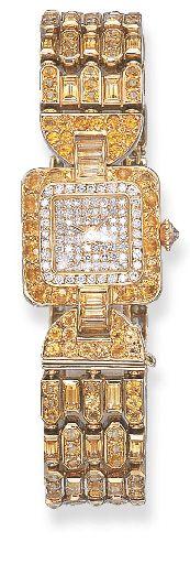 ❦ AN 18K GOLD, DIAMOND AND YELLOW SAPPHIRE WRISTWATCH, BY CARTIER