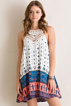 The sweetest silhouette and a charming print make the Border Boho Halter Dress one for the books! Features beautiful crochet detail for an elegant flare paired with fun print. 100% Rayon. Fully lined.