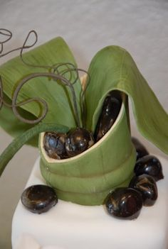 Bamboo sugar vase with sugar orchids and  pastillage river rocks.