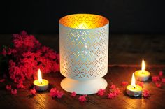 Use smaller pillar candles inside hurricane holders to create a more intense glow.