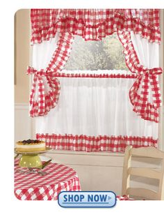 My grandmas kitchen was white with red handles and pulls on the cupboards, red 50's table and chairs and gingham curtains like this one.