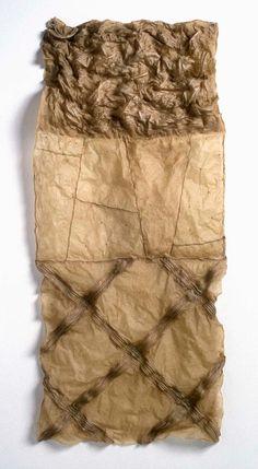 "Susan Warner Keene, ""piecing no. 4; 1996;  Materials: flax paper, linen cord, abaca fibre  Measurements: 97 x 43 x 5 cm/ 39 x 17 x 2 in."