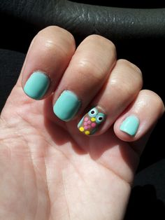 blue/green nail polish with owl art!!