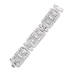 Platinum and Diamond Bracelet Centering a pear-shaped diamond weighing approximately 1.25 carats, further set with numerous round, baguette...