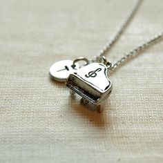 Piano initial necklace initial hand stamped by ShortandBaldJewelry, $19.75
