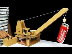 How to Make Remote Control Hydraulic CRANE From Cardboard In this video I show you how to make Remote Control Hydraulic CRANE from cardboard, it's quite fun . Cardboard Train, Cardboard Toys, Stem Projects, Projects For Kids, Toy Crane, Diy Tank, Robot Arm, Simple Machines, Woodworking Toys