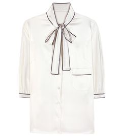 Dolce & Gabbana - Furag silk blouse - Dolce & Gabbana tap into the wearable pyjama style, opting for a sophisticated white silk blouse that pulls inspiration from chic bedroom wear. Loose-fitting and shimmering, this piece features a black trim that adds necessary structure. A chic pussy bow ties things off with elegance. seen @ www.mytheresa.com