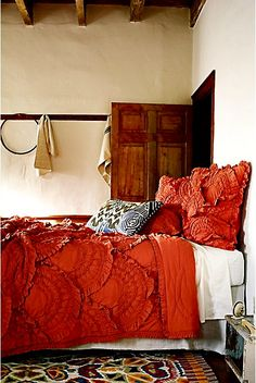 love this orange ruffle bedding--unfortunately it's from Anthropologie = $$$. Any suggestions for a less expensive version are much appreciated!