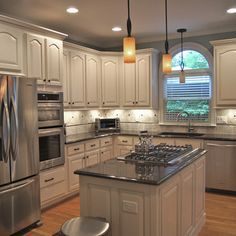 What our kitchen could look like if we keep our cathedral top doors, paint walls lt steel grey and paint cabinets ivory.