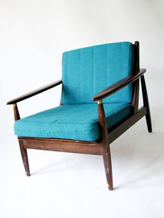 My grandma had one of these chairs- I loved it so much. Wish we could have kept it. Someday I'll find one & reupholster to a fun, popping print. - Midcentury modern lounge chair.