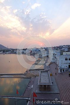 Photo about This is an aerial shot of Pushkar lake Rajasthan India during a dramatic sunset. Image of morning, pilgrims, reflect - 70733629 Rajasthan India, Pilgrim, Opera House, Shots, Clouds, Stock Photos, Sunset, Building, Travel
