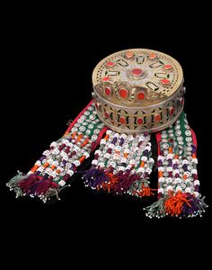 Iran (or Central Asia   Headdress; copper, silver foil decorations, carnelians, and three wool and felt decorated with silver hoops, white beads and embroidery   483$ ~ sold (Apr '14)