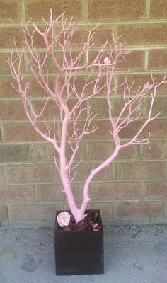 Rich pink 32in tree with brown base... perfect for jewelry storage or home decor.