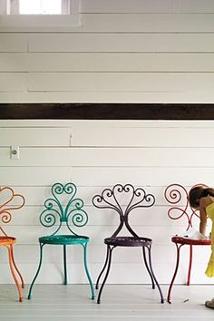 A garden chair of colourful flourishes, inspired by the designs of traditional wrought iron fencing. By British designer and artist David Le Versha.