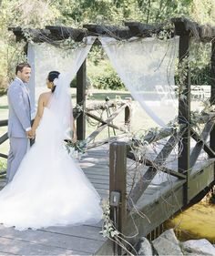 The soft white curtains on the wooden bridge bring such a nice romantic touch to this outdoor wedding. What a magical idea for a summer wedding. Photo by  http://aliciakingphotography.com Bride wore: http://ninashoes.com/bride-285?utm_source=Pinterest&utm_medium=Social%20Media%20Campaign&utm_term=Wedding%20Inspiration&utm_content=Outside%20by%20bridge%20Alicia%20King%20MJ&utm_campaign=Wedding Planner/Florist http://www.whimsy-weddings.com