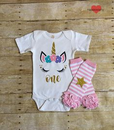 This Baby Girl First Birthday Onesie and Leg Warmers Unicorn set is too cute! Featuring a onesie made with non shedding gold glitter vinyl. Can have her name or age under the Unicorn. Add the pink and white star ruffle leg warmers to complete the look! They are 12 long and can fit babies