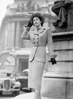 eba903c1d91 A woman modelling a tailored Simon Massey suit