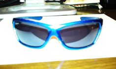 Blue with chrome flame sunglasses.