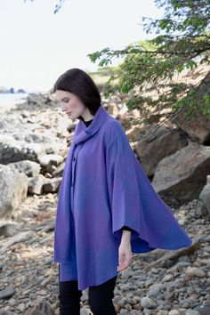 One of our best-selling wool capes out Triona Design purple heather cape has become one of our most coveted garments over the years. The vibrant purple is inspired by the wild heather growing along the Wild Atlantic Way. #donegaltweed #cape #wool #tweed #irishfashion #wearingirish #heather Irish Fashion, Wool Cape, Capes For Women, Donegal, Shawls, Tweed, Shop Now, Vibrant, Women Wear