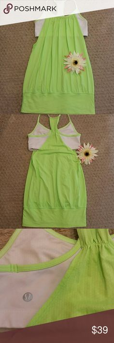Lululemon white &fluorescent green no limits tank Awesome Lululemon white &fluorescent green no limits tank. Built in bra, no pads included. Size 4. lululemon athletica Tops Tank Tops