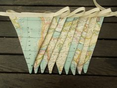 bunting is cute and so simple and very vintage, and you can have it in some areas because its not very classical like alex may like, but around some areas map bunting would look so cool. maybe on the outise like with the sign of wedding this way you know to decorate that a bit!