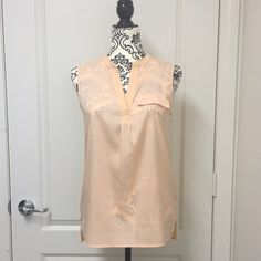 Calvin Klein Sleeveless Top Peach-colored top. It's hard to capture it's actual color in pics. The color is much better in person. Worn less than 5x. Have a small stain on the bottom part, but not noticeable when worn due to the shiny material. Will also fit a size S and possibly a size M since it's a loose style. Front - 100% polyester, Back - 95% rayon 5% spandex. Calvin Klein Tops Blouses