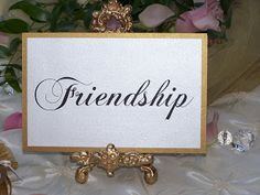 Creative way to name your tables, things you need in a marriage, friendship, gold tabletop easels