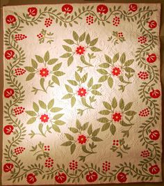 Antique red-and-green quilt at the National Quilt Museum, 200 years of hand quilting exhibit