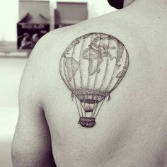 Dream is to travel the world one day, this would be such an awesome tatt
