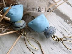 Blue Skies- matte sky blue ceramic birds. polymer nest beads. brass leaves. rustic blue bird earrings. bohemian nature. Jettabugjewelry by jettabugjewelry on Etsy https://www.etsy.com/listing/235443645/blue-skies-matte-sky-blue-ceramic-birds