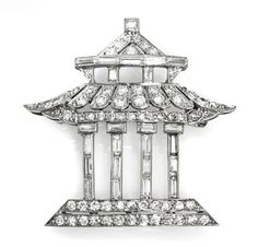 Vintage Platinum and Diamond Pagoda Brooch, containing 24 square and baguette cut diamonds and numerous round single cut diamonds.