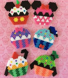 We love all the fun designs you can make with perler beads! These Mickey and Friend inspired cupcake designs made by are too cute! Perler Bead Designs, Hama Beads Design, Diy Perler Beads, Perler Bead Art, Perler Bead Emoji, Melty Bead Patterns, Pearler Bead Patterns, Perler Patterns, Beading Patterns