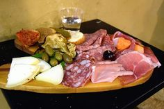 """#TypicalTuscanAppetizer (#antipasto): a variety of Tuscan cold cuts (Tuscan ham, salami and """"Finocchiona""""), Tuscan cheeses like the Pecorino cheese, green olives, liver patè """"crostini"""", tomato bruschetta... And of course a glass of a good red wine!  Follow us on Instagram: http://instagram.com/sunnytuscanytours"""