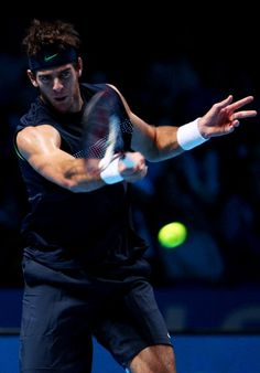 Juan Martin Del Potro Photos Photos - Juan Martin Del Potro of Argentina returns the ball during the men's singles final match against Nikolay Davydenko of Russia during the Barclays ATP World Tour Finals at the O2 Arena on November 29, 2009 in London, England. - ATP World Tour Finals - Day Eight