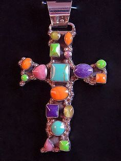 SoVintageous is offering this gorgeous sterling silver crucifix cross pendant with multiple bezel-set gemstones, handmade in Mexico.  The stones include Turquoise, Gaspeite, Rutilated Quartz, Sugilite