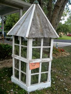 diy greenhouse made from windows | how cute the little greenhouse is very well made of recycled windows ...