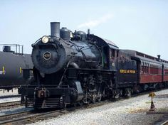 # 475, in her Norfolk and Western colors, pulls a passenger train into the yard.