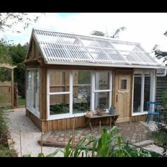 greenhouse from salvaged windows recycled windows greenhouse from old windows greenhouse recycled windows Old Window Greenhouse, Winter Greenhouse, Backyard Greenhouse, Small Greenhouse, Greenhouse Plans, Pallet Greenhouse, Homemade Greenhouse, Old Wood Windows, Recycled Windows