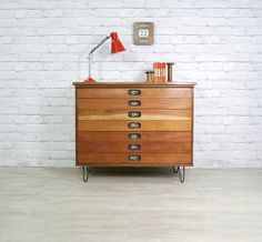 Vintage mid-century school plan chest mounted on steel hairpin legs.