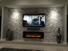 home theater rooms modern - home theater rooms ; home theater rooms small ; home theater rooms basements ; home theater rooms luxury ; home theater rooms diy ; home theater rooms modern ; home theater rooms seating ; home theater rooms ideas Living Room Tv, Living Room With Fireplace, Tv Wall Ideas Living Room, Stone Wall Living Room, Dining Room, Fireplace Tv Wall, Basement Fireplace, Fake Fireplace, Wall Entertainment Center
