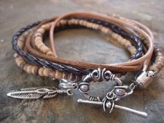 MEXCLA IN BROWN leather Wrap Bracelet with coconut Beads and feather (6) by AsaiBolivien on Etsy https://www.etsy.com/listing/75272356/mexcla-in-brown-leather-wrap-bracelet