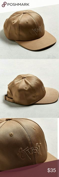 NWT Gold Stussy Sateen dad Hat Your favorite dad hat from Stussy updated in a shiny sateen that's only available at Urban Outfitters. Six-panel silhouette features a tonal embroidered logo at the front with a flat brim and stitched grommets at the crown. Finished with an adjustable strapback closure for the perfect fit. Stussy is a California-based streetwear label that delivers a collection of t-shirts, hoodies and accessories, all emblazoned with Shawn Stussy's iconic signature.  Content…