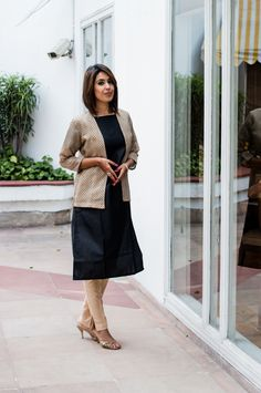 Jute silk kurta teamed with beige straight pants and the silk jacket on top is a killer
