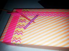 Gift, present, chevron masking tape, feather, tape, striped wrapping paper, pink, orange, yellow