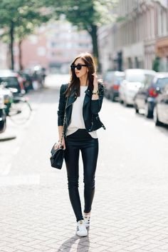 Barbora Ondrackova is looking sleek and elegant in a primarily leather-based outfit consisting of leggings, a white tee, and a classic biker jacket with rose gold zip detailing. Wear this look with a pair of Adidas Stan Smiths to steal Barbora's cute spring style! Top: Zara, Leggings: Balenciaga, Jacket: Topshop, Sneakers: Adidas.