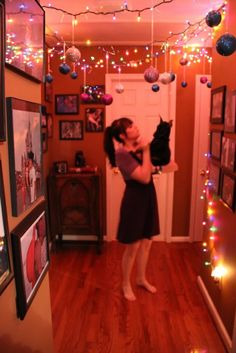 Hanging ornaments from Christmas lights. I did this every year in my college dorm room. -- might be a nice idea with balloons for a birthday. or heart garlands for valentines