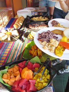 Typical breakfast in Costa Rica - pinto and huevos, plantain and empanada on the plate, now load up with fruit!
