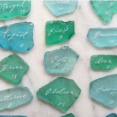 Sea glass escort cards- love love love!