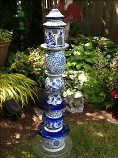 ": A blue ceramic totem.small birds might enjoy the ""house"" on top. Garden Totems, Glass Garden Art, Glass Art, Planter Garden, Garden Crafts, Garden Projects, Garden Whimsy, Outdoor Crafts, Glass Flowers"